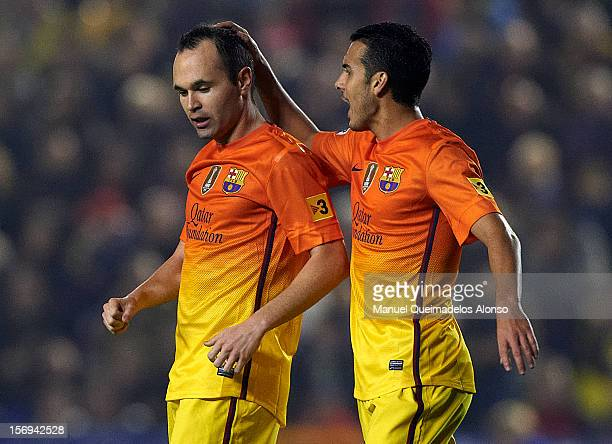 Andres Iniesta of Barcelona celebrates scoring with his teammate Pedro Rodriguez during the la Liga match between Levante UD and FC Barcelona at...