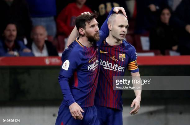 Andres Iniesta of Barcelona celebrates with his teammate Lionel Messi after scoring a goal during Copa del Rey Final soccer match between Sevilla and...