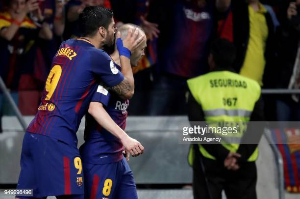 Andres Iniesta of Barcelona celebrates with his teammate Luis Suarez after scoring a goal during Copa del Rey Final soccer match between Sevilla and...