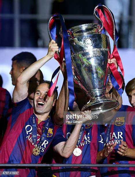 Andres Iniesta of Barcelona celebrates with the trophy after the UEFA Champions League Final between Juventus and FC Barcelona at Olympiastadion on...