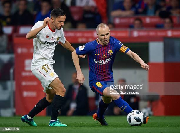 Andres Iniesta of Barcelona competes for the ball with Pablo Sarabia of Sevilla during the Spanish Copa del Rey Final match between Barcelona and...