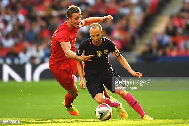 Andres Iniesta of Barcelona goes past Jordan Henderson of Liverpool during the International Champions Cup match between Liverpool and Barcelona at...