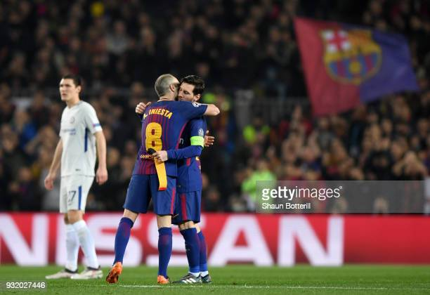 Andres Iniesta of Barcelona hands the captain's armband to Lionel Messi of Barcelona during the UEFA Champions League Round of 16 Second Leg match FC...