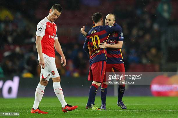 Andres Iniesta of Barcelona hugs after passing the captain's armband to his team mate Lionel Messi as he is replaced during the UEFA Champions League...