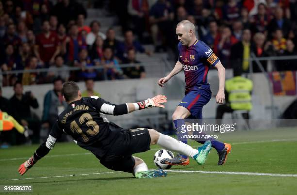 Andres Iniesta of Barcelona in action against David Soria of Sevilla during Copa del Rey Final soccer match between Sevilla and Barcelona at Wanda...
