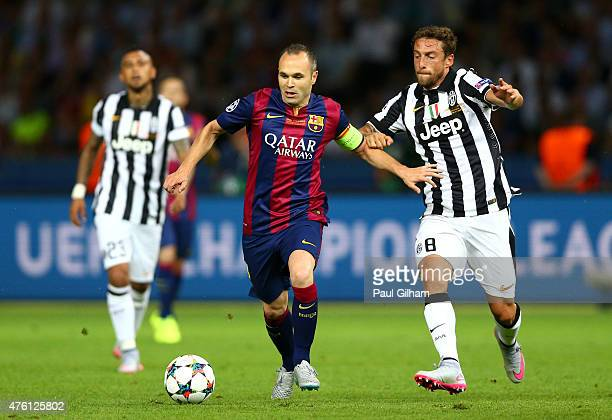 Andres Iniesta of Barcelona is closed down by Claudio Marchisio of Juventus during the UEFA Champions League Final between Juventus and FC Barcelona...