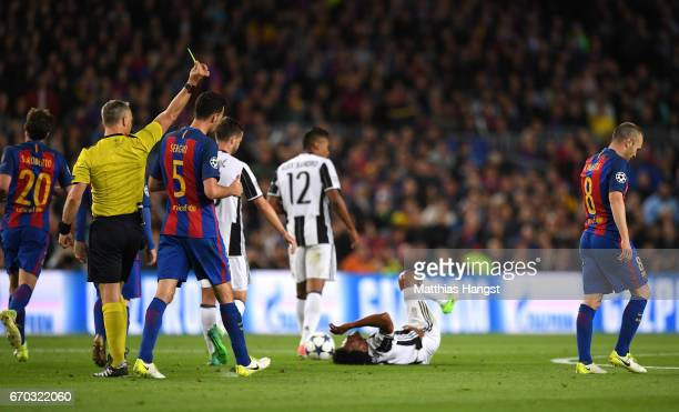 Andres Iniesta of Barcelona is shown a yellow card by referee Bjorn Kuipers during the UEFA Champions League Quarter Final second leg match between...
