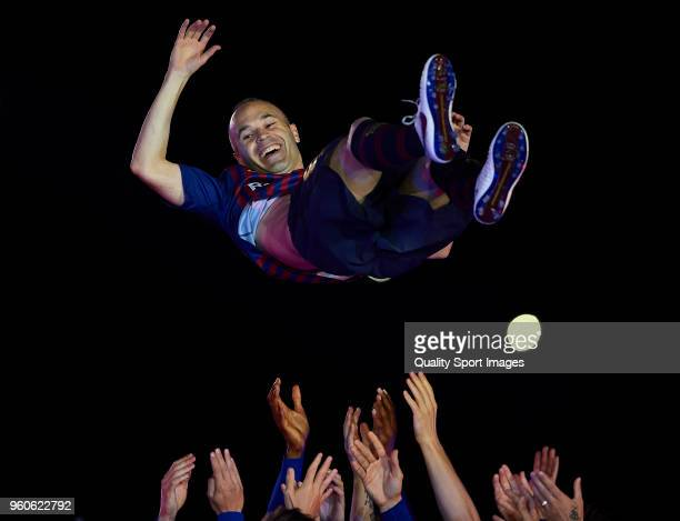 Andres Iniesta of Barcelona is thrown in the air by teammates after the La Liga match between Barcelona and Real Sociedad at Camp Nou on May 20, 2018...