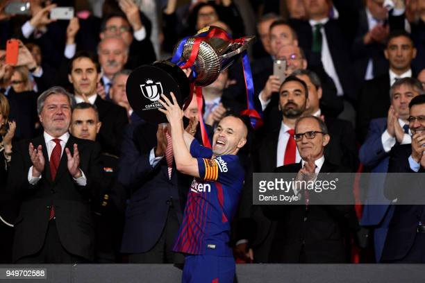 Andres Iniesta of Barcelona lifts the cup in his last cup final for the team with King Felipe V watching on during the Spanish Copa del Rey Final...
