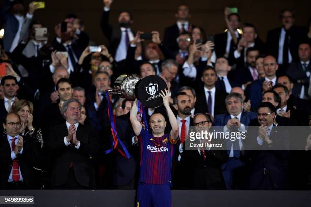 Andres Iniesta of Barcelona lifts the trophy after his teams win during the Spanish Copa del Rey match between Barcelona and Sevilla at Wanda...