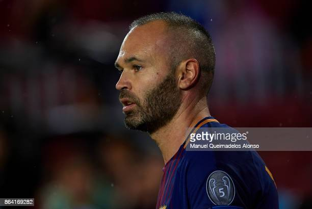 Andres Iniesta of Barcelona looks on during the UEFA Champions League group D match between FC Barcelona and Olympiakos Piraeus at Camp Nou on...