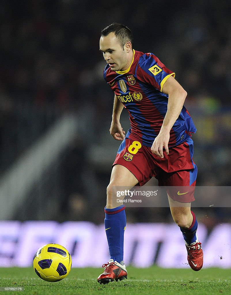 Andres Iniesta of Barcelona runs with the ball during the La Liga match between Barcelona and Real Sociedad at Camp Nou Stadium on December 12, 2010 in Barcelona, Spain. Barcelona won 5-0.