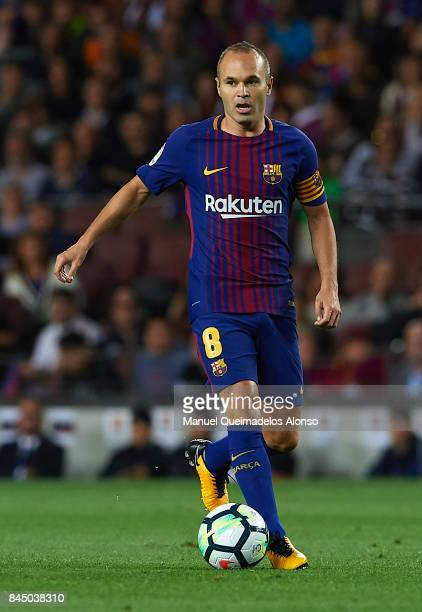 Andres Iniesta of Barcelona runs with the ball during the La Liga match between Barcelona and Espanyol at Camp Nou on September 9 2017 in Barcelona...