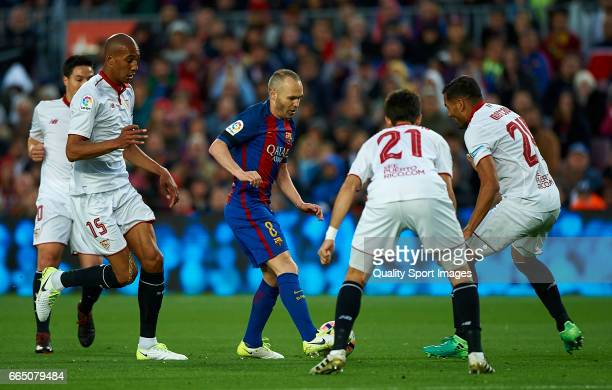 Andres Iniesta of Barcelona surrounded by players of Sevilla during the La Liga match between FC Barcelona and Sevilla FC at Camp Nou Stadium on...