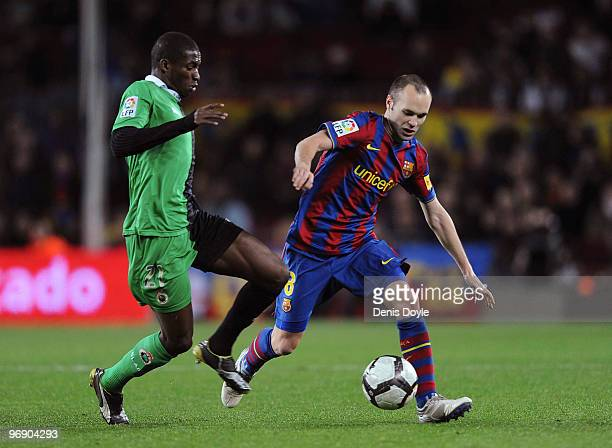 Andres Iniesta of Barcelona takes on Pape Diop of Racing Santander during the La Liga match between Barcelona and Racing Santander at Camp Nou...
