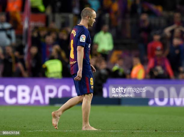 Andres Iniesta of Barcelona walks off after the La Liga match between Barcelona and Real Madrid at Camp Nou on May 6 2018 in Barcelona Spain