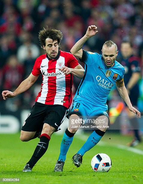 Andres Iniesta of FC Barcelola duels for the ball with Benat Etxebarria of Athletic Club during the Copa del Rey Quarter Final First Leg match...
