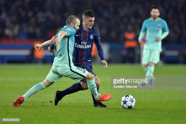 Andres Iniesta of FC Barcelona and Marco Verratti of Paris-Saint Germain fight for the ball during the UEFA Champions League Round of 16 first leg...