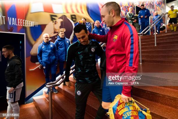 Andres Iniesta of FC Barcelona and Pedro Rodriguez of Chelsea FC speak in the tunnel before the UEFA Champions League Round of 16 Second Leg match...