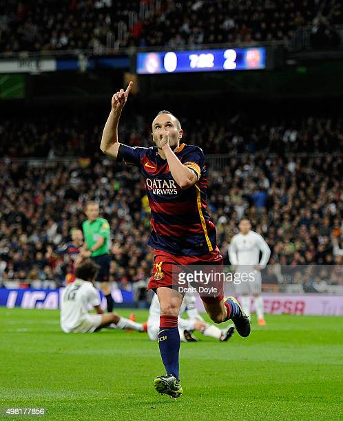 Andres Iniesta of FC Barcelona celebrates after scoring his team's 3rd goal during the La Liga match between Real Madrid and Barcelona at Estadio...