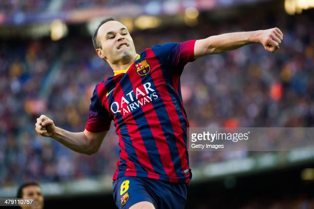 Andres Iniesta of FC Barcelona celebrates after scoring his team's third goal during the La Liga match between FC Barcelona and CA Osasuna at Camp...