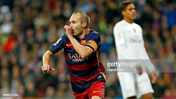 Andres Iniesta of FC Barcelona celebrates after scoring his team's third goal during the La Liga match between Real Madrid CF and FC Barcelona at...