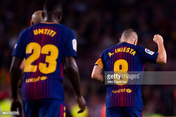 Andres Iniesta of FC Barcelona celebrates after scoring his team's second goal during the La Liga match between Barcelona and Malaga at Camp Nou on...