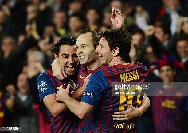 Andres Iniesta of FC Barcelona celebrates scoring with his teammates Lionel Messi and Xavi Hernandez during the Champions League quarterfinal second...