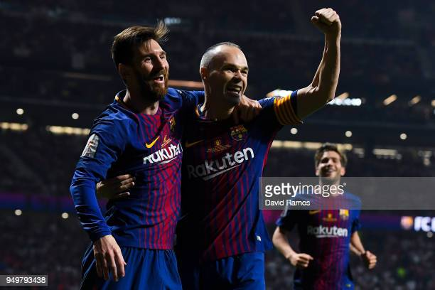 Andres Iniesta of FC Barcelona celebrates with his team mate Lionel Messi after scoring his team's fourth goal during the Spanish Copa del Rey Final...