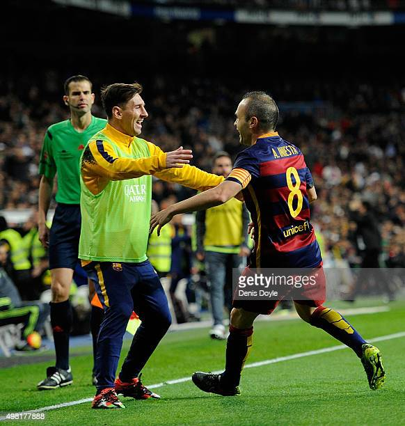 Andres Iniesta of FC Barcelona celebrates with Lionel Messi after scoring his team's 3rd goal during the La Liga match between Real Madrid and...