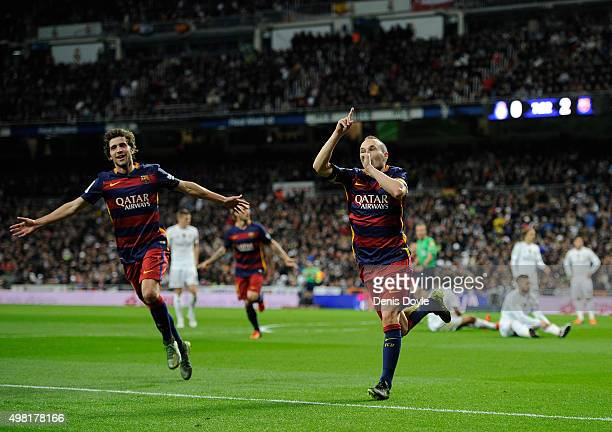 Andres Iniesta of FC Barcelona celebrates with Sergi Roberto after scoring his team's 3rd goal during the La Liga match between Real Madrid and...