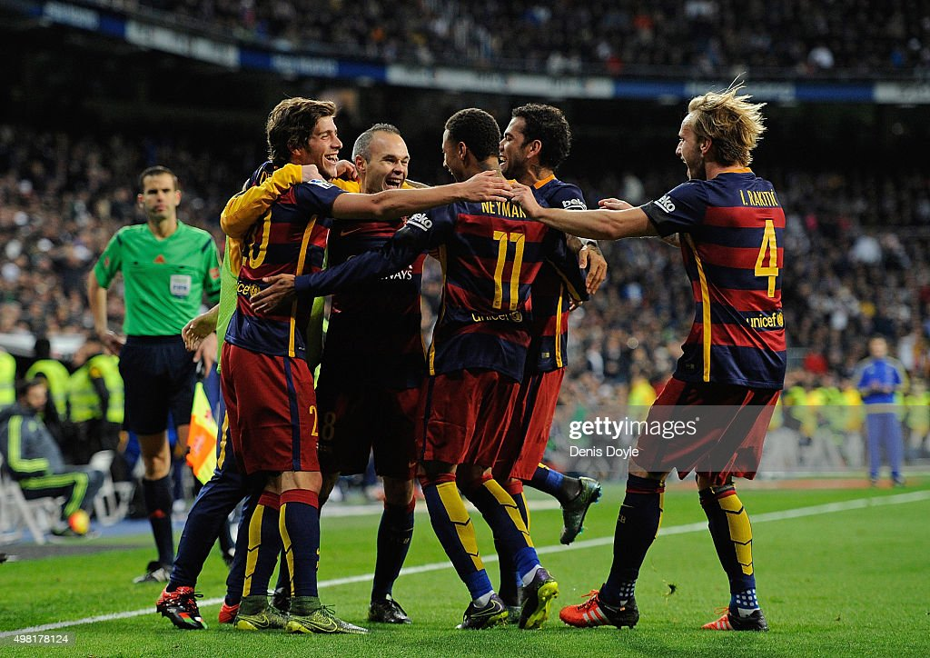 Andres Iniesta of FC Barcelona celebrates with teammates after scoring his team's 3rd goal during the La Liga match between Real Madrid and Barcelona at Estadio Santiago Bernabeu on November 21, 2015 in Madrid, Spain.