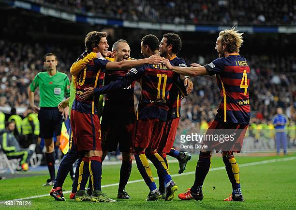 Andres Iniesta of FC Barcelona celebrates with teammates after scoring his team's 3rd goal during the La Liga match between Real Madrid and Barcelona...