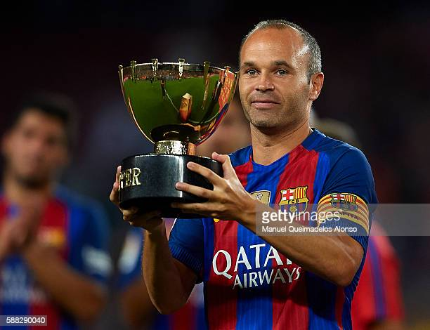 Andres Iniesta of FC Barcelona celebrates with the trophy after winning the Joan Gamper trophy match between FC Barcelona and UC Sampdoria at Camp...