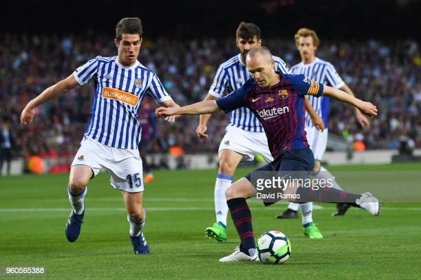 Andres Iniesta of FC Barcelona competes for the ball with Aritz Elustondo of Real Sociedad de Futbol during the La Liga match between Barcelona and...