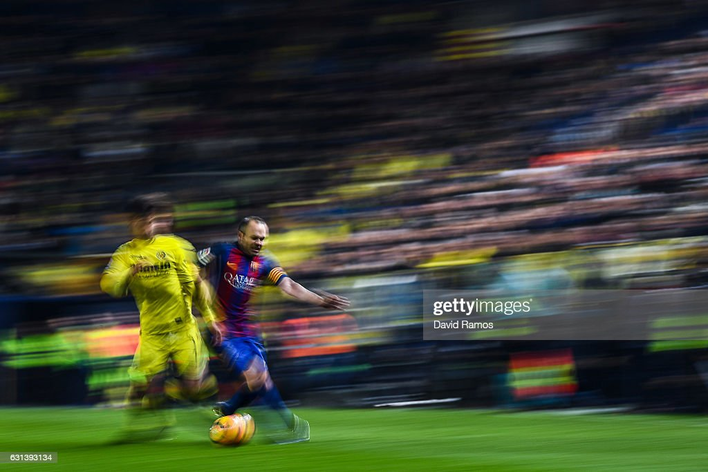 Andres Iniesta of FC Barcelona competes for the ball with Manu Trigueros of Villarreal CF during the La Liga match between Villarreal CF and FC Barcelona at Estadio de la Ceramica stadium on January 8, 2017 in Villarreal, Spain.