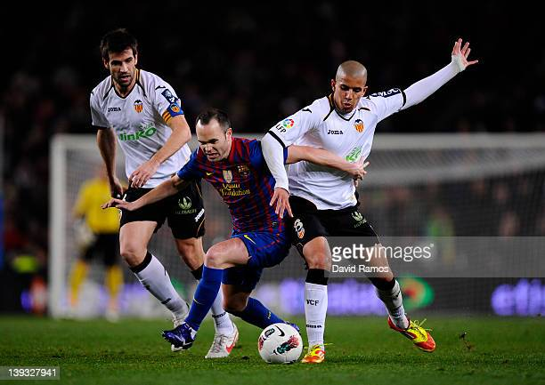 Andres Iniesta of FC Barcelona duels for the ball with David Albelda of Valencia CF and Sofiane Feghouli of Valencia CF during the La Liga match...