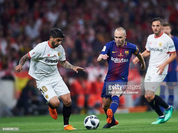 Andres Iniesta of FC Barcelona duels for the ball with Ever Banega of Sevilla FC during the Spanish Copa del Rey Final between Barcelona and Sevilla...
