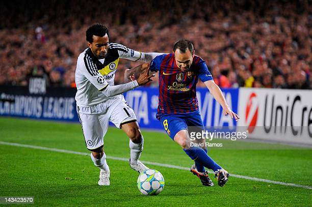 Andres Iniesta of FC Barcelona duels for the ball with Jose Bosingwa of Chelsea during the UEFA Champions League Semi Final second leg match between...