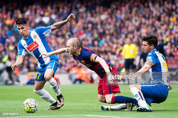 Andres Iniesta of FC Barcelona fights for the ball between Hernan Perez and Javi Lopez of RCD Espanyol during the La Liga match between FC Barcelona...
