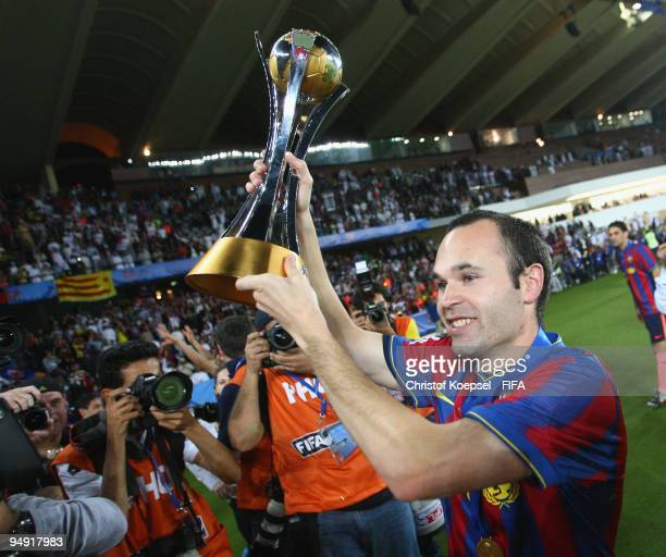 Andres Iniesta of FC Barcelona holds the cup aloft after the FIFA Club World Cup Final match between Estudiantes LP and FC Barcelona at the Zayed...