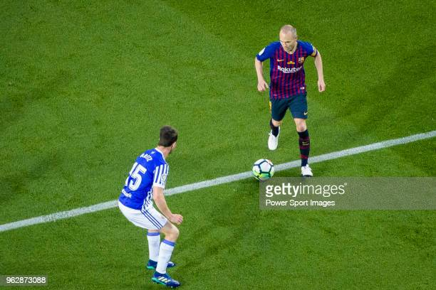 Andres Iniesta of FC Barcelona in action against Aritz Elustondo of Real Sociedad during the La Liga match between Barcelona and Real Sociedad at...