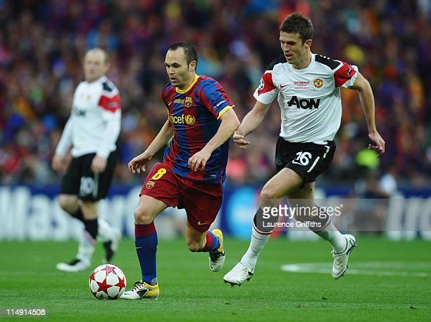 Andres Iniesta of FC Barcelona in action against Michael Carrick of Manchester United during the UEFA Champions League final between FC Barcelona and...
