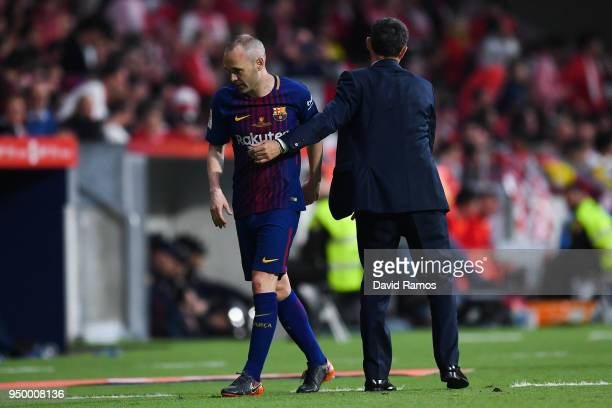 Andres Iniesta of FC Barcelona is comforted by his Head coach Ernesto Valverde of FC Barcelona as he is subbed off during the Spanish Copa del Rey...