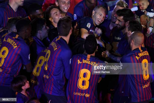 Andres Iniesta of FC Barcelona is tossed into the air by his team mates at the end of the La Liga match between Barcelona and Real Sociedad at Camp...