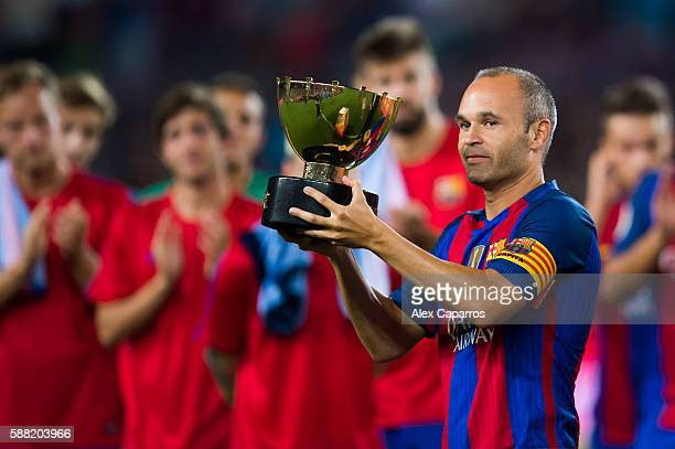 Andres Iniesta of FC Barcelona lifts the Joan Gamper trophy after the Joan Gamper trophy match between FC Barcelona and UC Sampdoria at Camp Nou on...