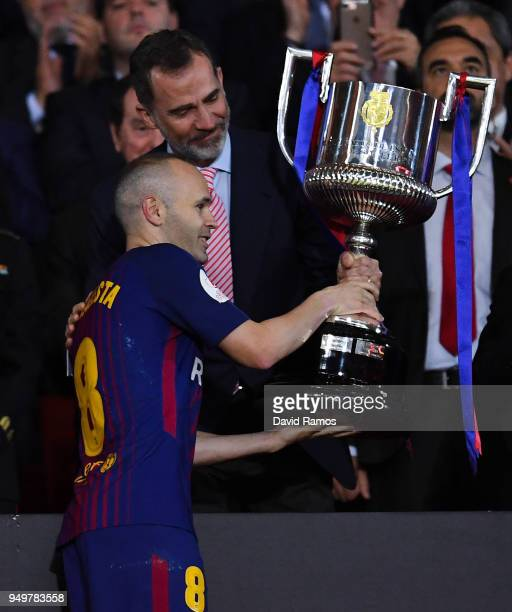 Andres Iniesta of FC Barcelona lifts the trophy after winning with his team the Spanish Copa del Rey Final match between Barcelona and Sevilla at...