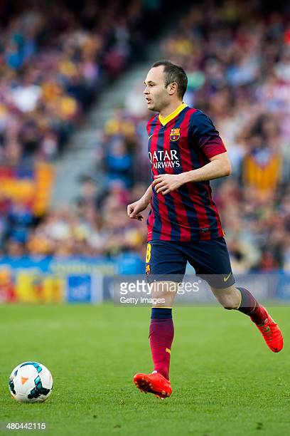 Andres Iniesta of FC Barcelona runs with the ball during the La Liga match between FC Barcelona and CA Osasuna at Camp Nou on March 16 2014 in...