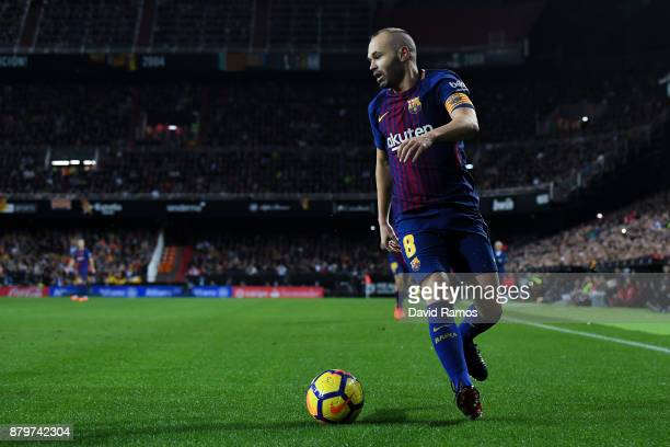 Andres Iniesta of FC Barcelona runs with the ball during the La Liga match between Valencia and Barcelona at Mestalla stadium on November 26 2017 in...