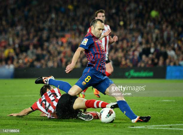 Andres Iniesta of FC Barcelona scores his sides opening goal past Borja Ekiza of Athletic Bilbao during the la Liga match between FC Barcelona and...